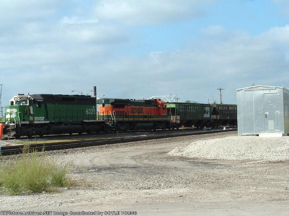 BNSF 6321 heads a mixed freight toward the yard.