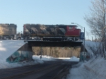CN CROSSING OVER THE ROAD ON A COLD WINTER MOURNING