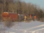 A MIXED FREIGHT IN THE EARLY MOURNING SUN