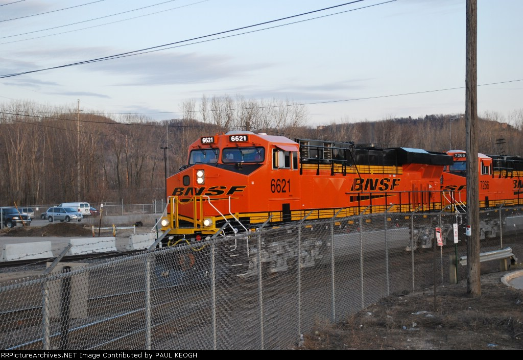 BNSF 6621 leads BNSF 7266 and BNSF 7268 past me on the south end of BNSF LA Crosse yard as I take this photo from the hood of my truck on the Z CHI-PTL