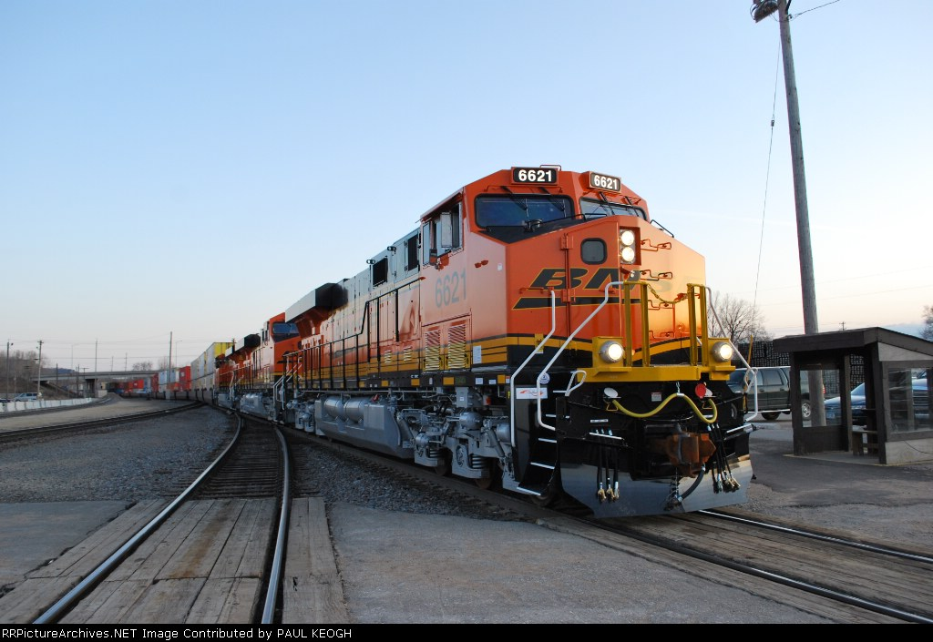 BNSF 6621 with BNSF 7266 and BNSF 7268 all brand new ES's on their first revenue run west on the Z CHI-PTL out ot the GE Locomotive plant at Erie, PA.