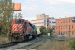 CP 5911 leads  an assortment of EMD power, bringing an ethanol train into Kenwood yard at Church St d