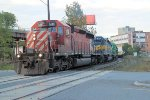 An inbound ethanol traion crosses Church St at Kenwood Yard with an assortment of SD40's