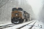 Westbound ethanol K697 rubles into town amidst a heavy snow squall