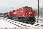 Clean ES44AC 8951 leads an empty ethanol train, departing Kenwood yard at Church St crossing