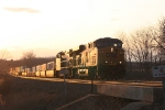 The setting sun behind it, Q164 rolls east to Syracuse, Selkirk, and eventually New Jersey
