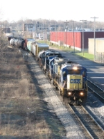 CSX 7549 winds through town leading Q335-16