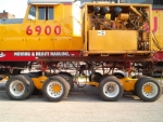 UP 6900 and her new engine to move her today.