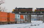 Iowa Interstate units pass over westbound CSX stack train