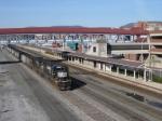 A loaded coal train passes the Altoona Amtrak station