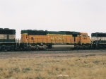 BNSF 8863 is 2nd of 3 SD70MAC units wb