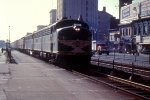 ERIE 821 heads through the heart of Downtown Passaic,NJ.  All of this is long gone.