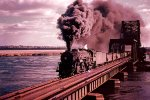 An Erie 2-8-4 leads this freight across the HX drawbridge over the Hackensack River from Secaucus into Rutherford.