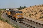 UP 5457 leads the southbound QRVWC past the top of Sandcut decending into Bena. Note the SD90MAC as the second unit.