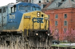 CSX 7675 along Commerce Street with old Piedmont Flour Mills building in background