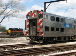 IAIS 706 sits in the yard as a newer Metra Electric car waits at the end of the Blue Island Branch