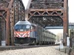METX 412 shoves its inbound train away