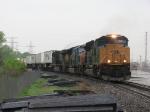 CSX 4838 heads east through the rain with Q110