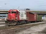 SOO 4435 leads a short cut of cars out of the yard for headroom