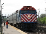 METX 115 slows for its station stop