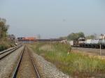 An EJ&E State Line coal train rolls onto the bridge as B09 heads west