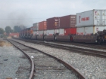 A BNSF train barreling through Fullerton with the 2nd engien smoking very badly!!!