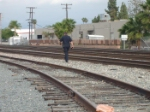 THe police officer crossing the tracks to try to find the people who were trying to commit suicide