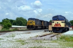 CSX 516 leads Q275 south past L&N E8 796 at the old L&N Depot, Railpark and Museum 1:09pm 5/23/09