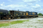 MCVX 21212 Caboose and U36B MCVX 7764 are on CSX Q275 south passing L&N Depot 5/23/09