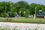 CSX 6066 has pulled up to the crossing on the Memphis Line before shoving back into the yard 6/17/09