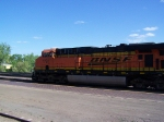 BNSF 7791 Blows Past the Amtrak Depot With a Grain Train