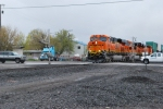 BNSF 7293 crosses the crossing with my Freightliner truck in the left rear background :)