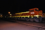 BNSF 7272 lights up her swoosh logo as BNSF 7485 waits to roll east on the next track.