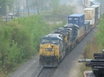 Pouring rain makes for a cool shot as CSX stack train leaves the former B&OCT 59th St yd