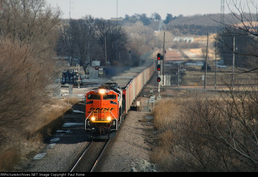 BNSF 9392 snakes westbound empties through the plant