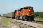 BNSF 9359, and a GE EVO lead eastbound coal loads