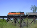 BNSF 5652 leads a westbound hopper train over the Missouri River bridge