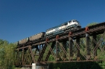 BNSF 9798 is working a loaded coal train eastbound on the Missouri River bridge