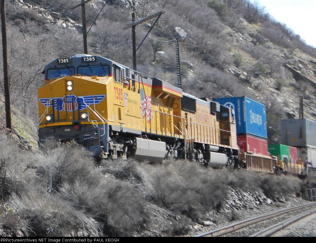 UP 7385 gets closer to me as she rolls west into Ogden, Ut.
