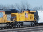 UP 7347 rolls west as a 3d unit on a grain train towards North Platte yard.