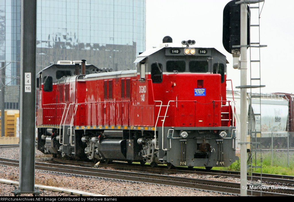 The TRE dispatcher is trying to get a hold of DGNO 140 as it waits for Amtrak to pass around and head west