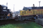 UP 2954, EMD SD40-2, rolled into the turntable pit but fuel tank caught on rail before going all the way in, at Proviso