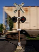 Southbound freight passes and elder crossing signal.