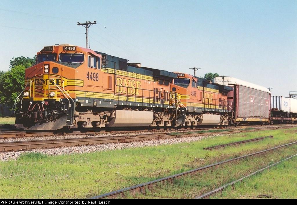 Westbound vehicle train through University