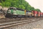 Westbound stack train behind rare power
