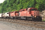 Eastbound grain train crosses over to enter yard