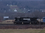 NS 5063 leads C90 west with the village of Adamsville as a backdrop