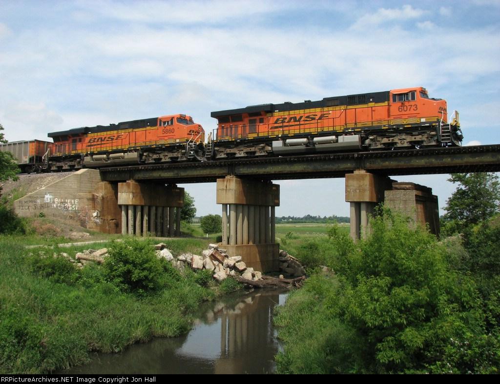 BNSF 6073 & 5860 head east over Coal Creek with coal loads