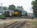 The IAIS conductor looks on as the TZPR pulls south through the yard
