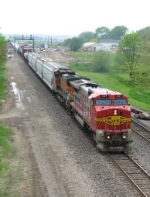 BNSF 521 & 570 work east with a general freight